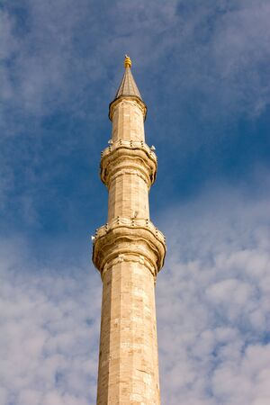 Minaret of Muslim mosque Religion, islam, tourism and travel concepts