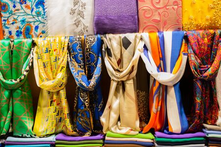 Pile of bright Multi-colored pieces of fabric in a bazaar Stock Photo