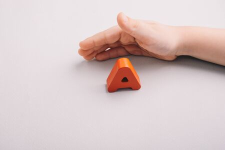 Colorful Letter A of Alphabet made of wood in hand