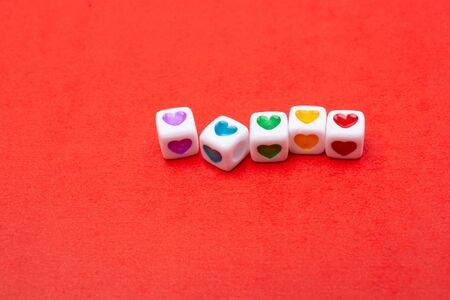 Colorful hearts in cubes for Valentine's day love concepts.