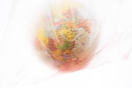 World globe in plastic bag isolated on white background