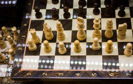 Intellectual game -chess. Wooden chess pieces on the chessboard