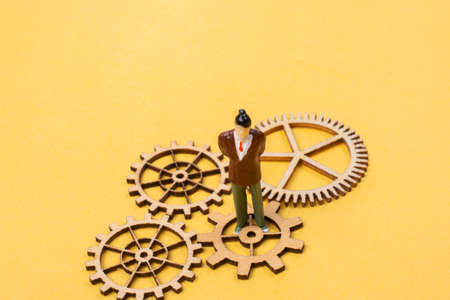 Industrial composition. Man with cogwheel gears Stockfoto