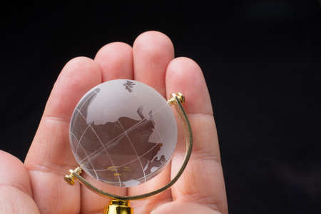 Glass globe for environment and conservation. Global business or education concepts