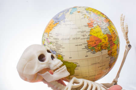 the earth in a skeleton hand Imagens
