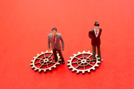Industrial composition. Men with cogwheel gears