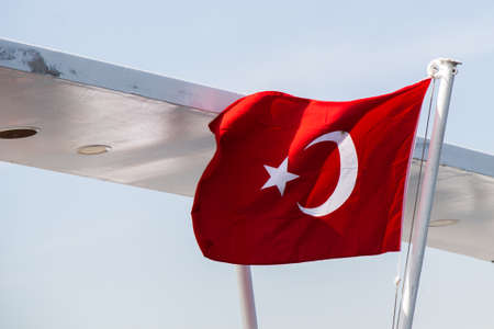 Turkish national flag hang on a pole in open air Standard-Bild