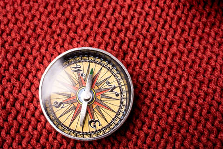 Compass tool on red texture fabric