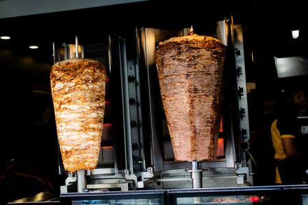 Traditional Turkish food Doner Kebab. Turnspit skewing kebap kebab shawarma Reklamní fotografie