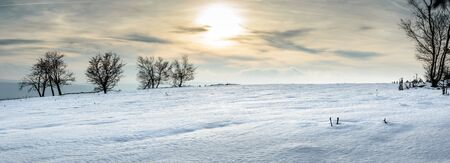 Poland, Winter landscape on a sunny day in the hills.