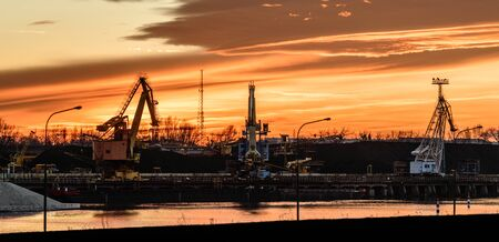 Poland, The river bed in the coal unloading zone at the thermal power plant, sunset. Imagens