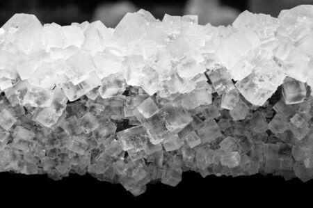 Poland, Wieliczka, salt mine natural salt crystals formed on wood.