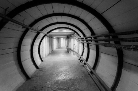 Poland, A hollow tunnel in the rock, a lighted underground passage.