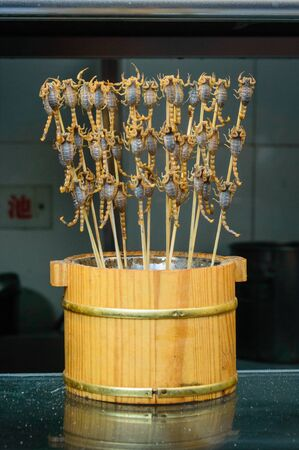Scorpion skewers, live scorpion studded on a skewer stick.