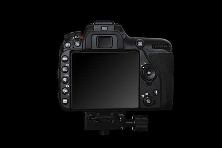 A professional digital camera with a large touch screen, many buttons make the camera easier to use. Camera mounted on a tripod, view from the back on a black background.