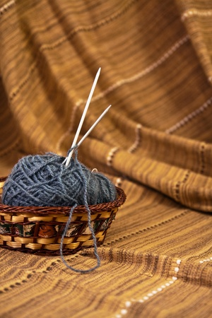 Balls of colored yarn for hand knitting in a decorative basket photo