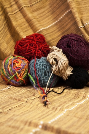 Balls of colored yarn for hand knitting on decorative tablecloth Stock Photo - 9527093