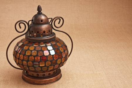 Interior Oriental brass lamp with a colorful bit of glass for decoration