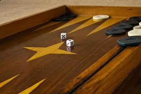 Ramshackle board backgammon dice, white and black checkers Stock Photo - 9773609