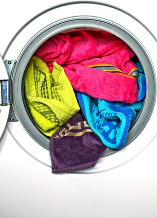 Colored towels in washing machine Stock Photo - 9999615