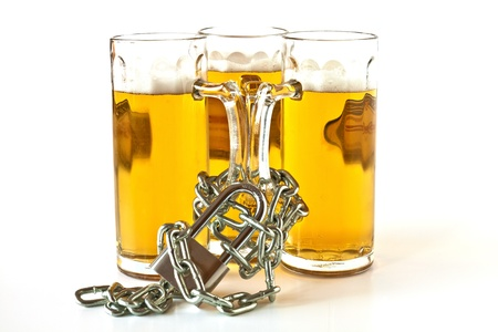 Three pints of beer shackled with chains and locked with a padlock photo