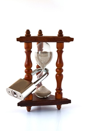 imprisoned: Decorative hourglass with a large metal locked padlock Stock Photo