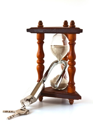 constraint: Decorative hourglass with a large metal locked padlock Stock Photo