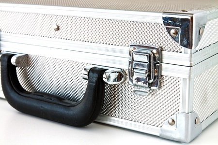 Metal suitcase with a different use of white background photo