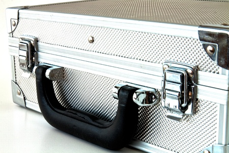 Metal suitcase with a different use of white background Stock Photo - 10668348