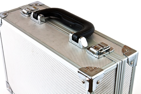 Metal suitcase with a different use of white background Stock Photo - 10668345
