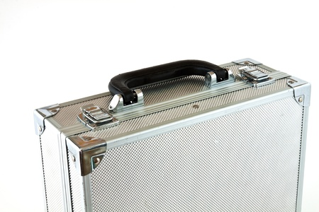 Metal suitcase with a different use of white background Stock Photo - 10668342