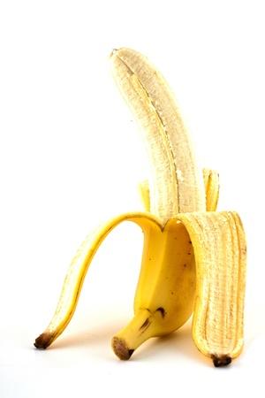 peeled banana: Ripe peeled banana isolated on white background Stock Photo