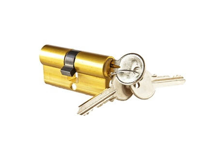 Brass cartridge cylinder with keys on a white background photo