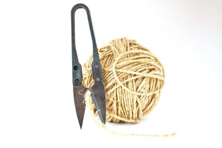 Small precision scissors and a ball of string natural material photo