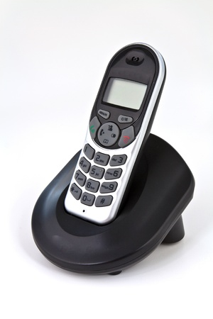 Home kabellosen Telefon auf der Ladestation platziert Standard-Bild - 12338496