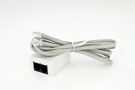 Kabel-und ADSL-Buchse zum Anschluss der Telefonleitung mit einem globalen Netzwerk Standard-Bild - 12338490