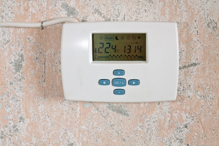 Electronic programmer wall to regulate temperature in the house photo