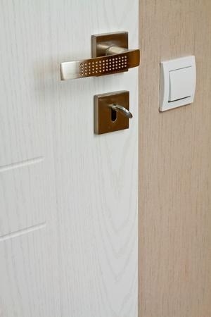 Modern metal hardware for interior doors in a geometric shape photo