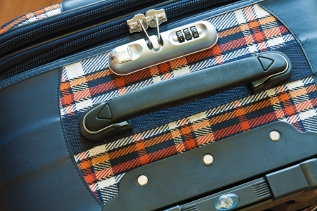 holdall: Details of colored cloth travel bag on the wooden top