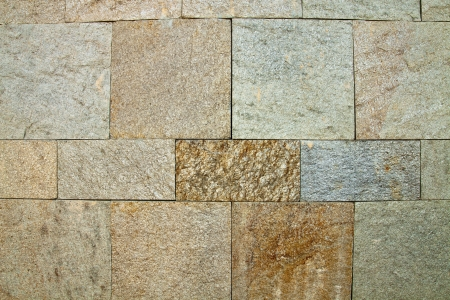 cladding tile: Decorative exterior wall covering resembling a stone wall