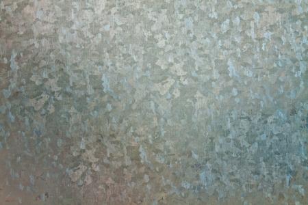 De chapa de acero galvanizado con formas abstractas en la superficie
