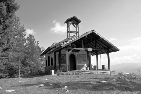 Christian chapel in the mountains in black and white tones photo