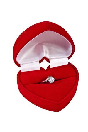 Red velvet box for an engagement ring on white background photo