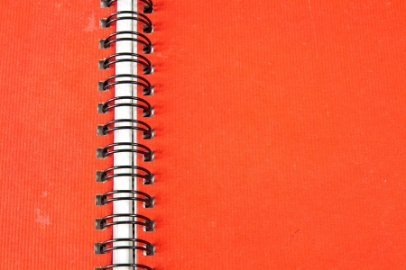 Spiral notebook with red hardcover for writing texts photo