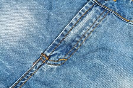 close range: Detail of blue denim pants at close range