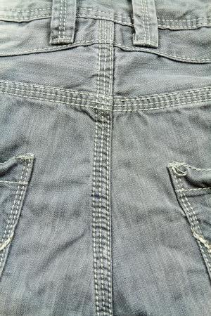 close range: Detail of gray denim pants at close range