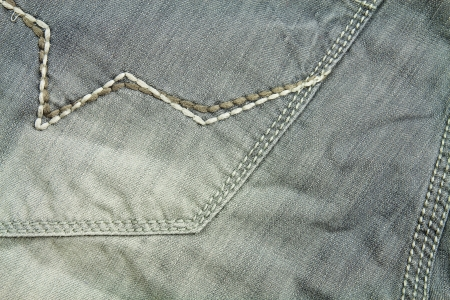 Detail of gray denim pants at close range photo