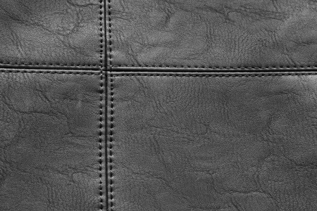 Detail of black leather with stitching in closeup 版權商用圖片