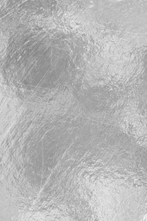 Sheet of silver foil surface scratches and dark spots photo