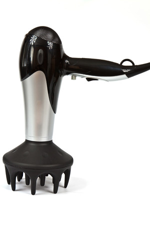 Professional electric hair dryer with a stylish design in black and silver photo